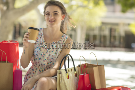 smiling young woman with shopping bag