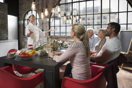 female chef congratulating participants of a