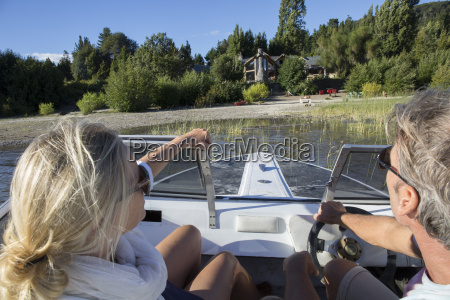 portrait of mature couple in motorboat