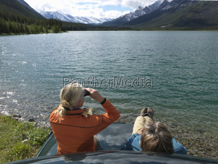 couple sits on hood of truck