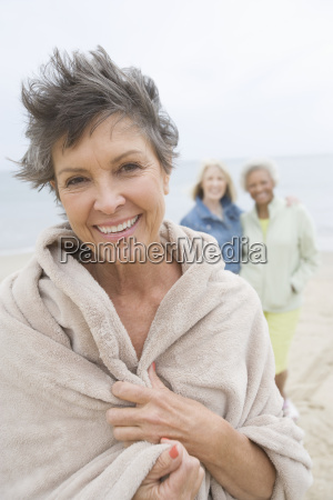 mature woman wrapped in towel on
