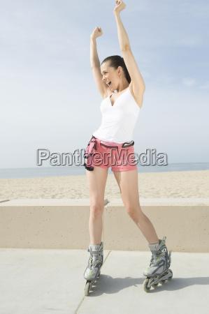 ecstatic woman on inline skates