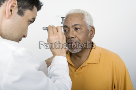doctor testing patients eye at clinic