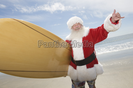 santa claus with surf board on