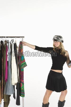 fashion stylist with clothes rail