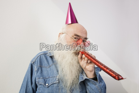 portrait of senior man wearing party