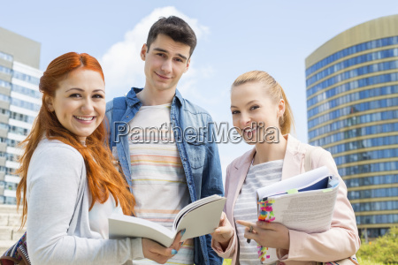 portrait of happy young university students