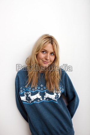 portrait of smiling woman in sweater