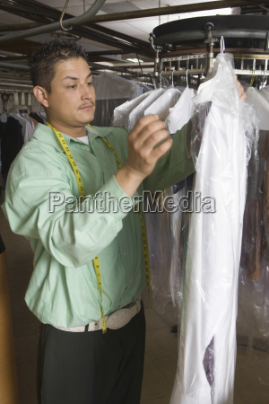 owner working in laundry