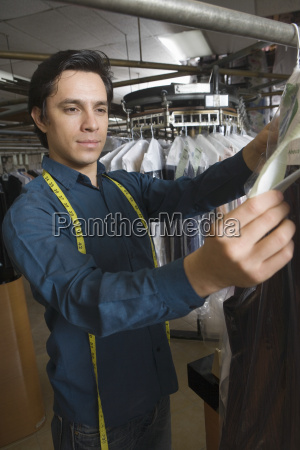 laundry owner checking clothes