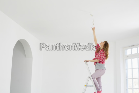full length of woman on ladder