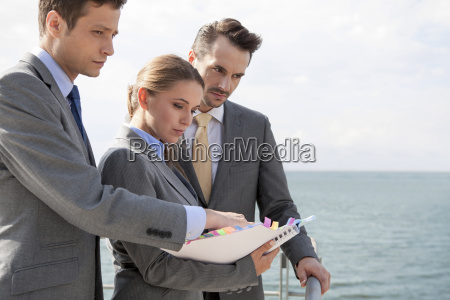businessteam with book standing on terrace