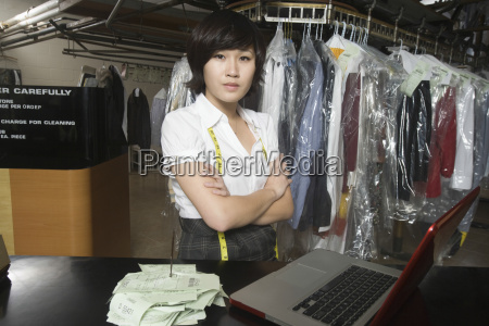 confident woman with receipt spike and