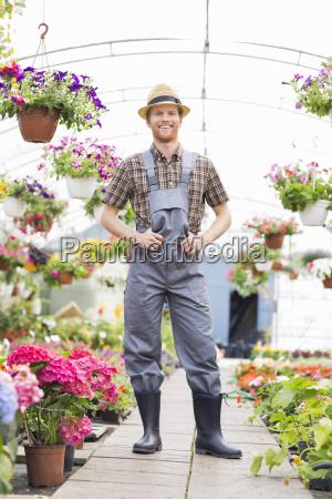 full length portrait of happy gardener