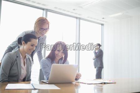 businesswomen using laptop in office