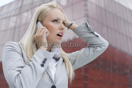 close up of shocked businesswoman communicating