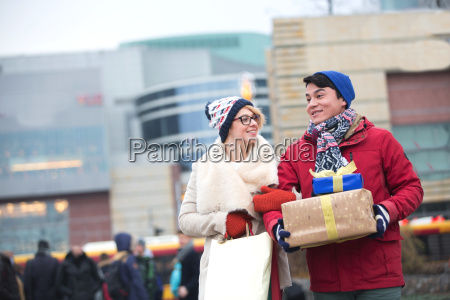 happy couple with gifts and shopping
