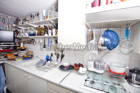 interior of domestic kitchen with utensils