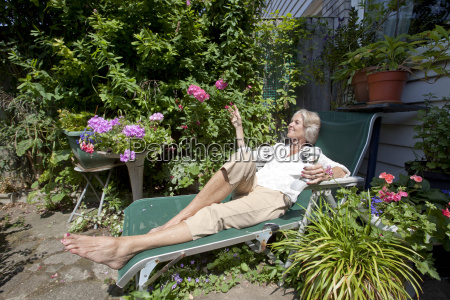 senior woman with wineglass relaxing on