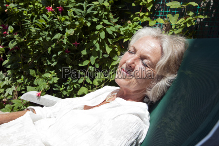 senior woman with eyes closed relaxing