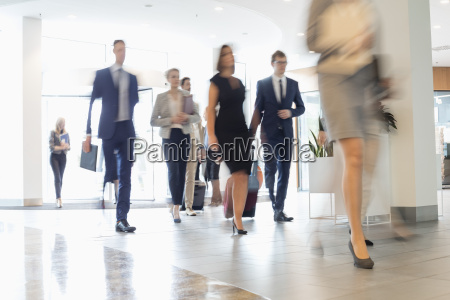 blurred motion of business people walking