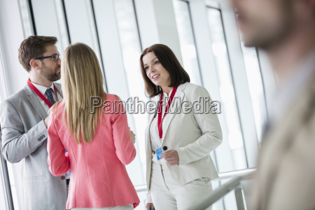 confident business people discussing in brightly