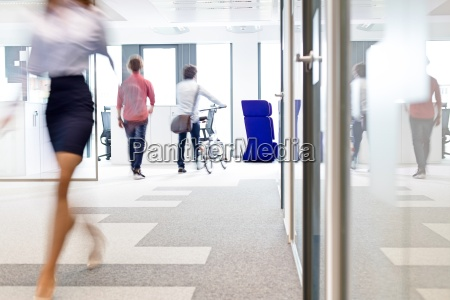 blurred motion of businesswoman walking with