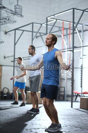 full length of men exercising in