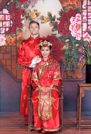 mixed race bride and groom in
