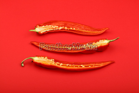 three cut hot chili peppers on