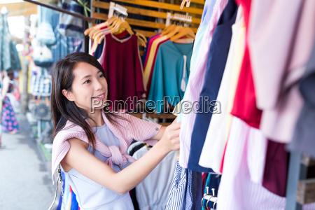 asian woman shopping in street market