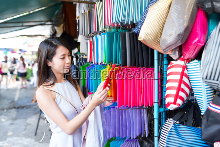 woman shopping in market in bangkok