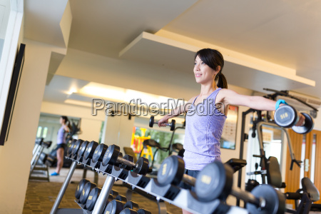 woman doing exercises with dumbbells in