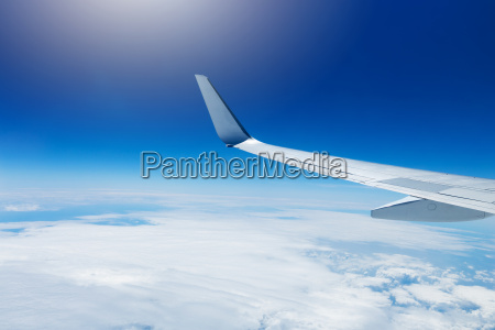 wing of an airplane flying high