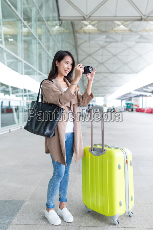 asian woman shooting by camera with