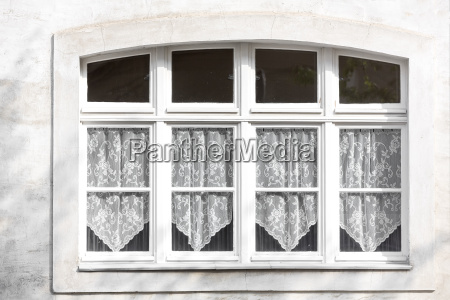 window with lace curtains at a