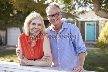 portrait of mature couple looking over