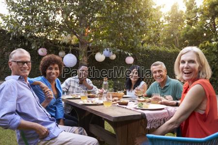 portrait of mature friends enjoying outdoor