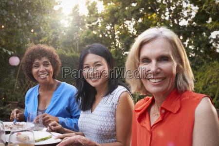 portrait of mature female friends enjoying