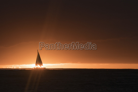 silhouette of yacht in sea against