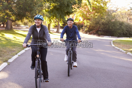 front view of senior couple cycling