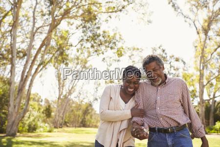 outdoor shot of mature couple walking