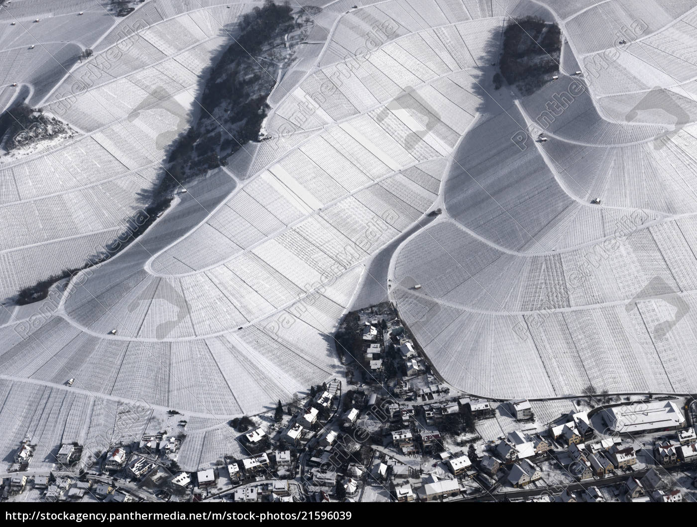 aerial, view, of, town, by, snow - 21596039