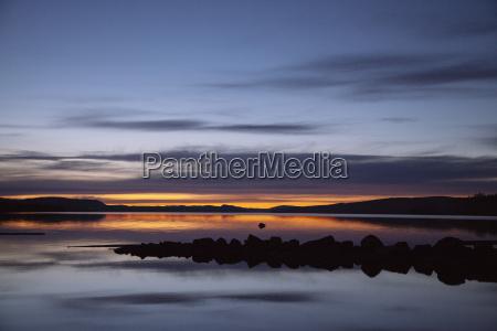 idyllic view of lake against dramatic