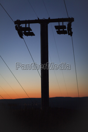 low angle view of silhouette electricity