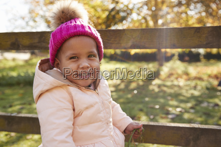 young girl on autumn walk standing