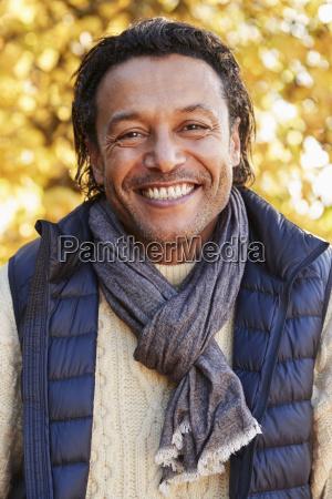 outdoor portrait of mature man wearing
