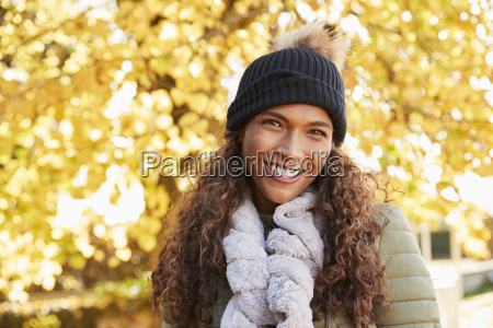 outdoor portrait of smiling woman wearing