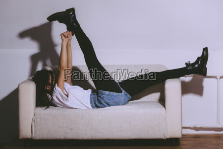 side view of playful woman lying