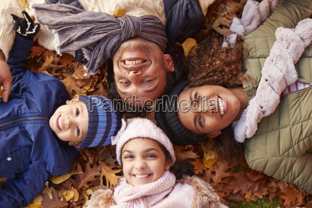 overhead portrait of family lying in